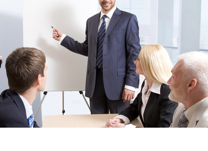 Business trainer Have you ever seen a training stock photo where someone was NOT pointing at something 2 - Training Manajemen Pelabuhan