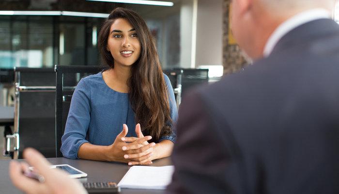 smiling young woman interview - Training Prinsip-prinsip Mengenal Nasabah